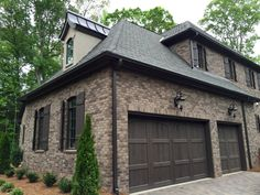 ARH Asheville 1131F Plan (Exterior 40) Stone: Oakridge (gray mortar), Brick: Boral Bastille, Room: Grand Manor Tudor Brown, Metal Roof: Dark Bronze, Soffits/Fascia/Trim: SW7020 Black Fox, Stucco: #210 London White, Window Frames: SW7038 Tony Taupe, Shutters/Columns/Cedar Brackets: SW3001 Shagbark, Entry Porch: Crab Orchard Brown, Front Door/Garage Door Stain: SW3518 Hawthorne, Rear Porch Flooring: Daltile Ayers Rock Majestic Mound (Grout #165 Delorean Gray)