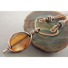 VERY cool framing of stone, AND the way the cord is tied on! - Leather copper necklace with framed honey brown agate with arch