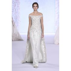 """Look 44: Pale mint silk zibeline off-the-shoulder gown with detachable cape, embroidered with floral metallic thread, silver bullion, crystals and glass…"""
