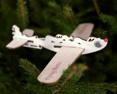 the Flying Santa cards are made from balsa wood with a laser-cut decoration showing Santa and his flying reindeer.