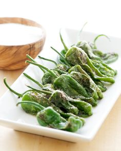Pan-Fried Padron Peppers - Not at all hot and still have a peppery taste. Add lime and sea salt. Sooo good!