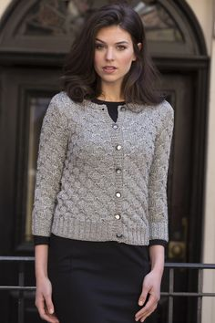 Metropolitan Cardigan in CELINE: A vintage-inspired knit cardigan, modernized by sparkly metallic yarn, CELINE. The allover stitch pattern utilizes the floats created by slipped stitches to create a textured pattern. Available in sizes Small (Medium, Large, XL, 2X, 3X)