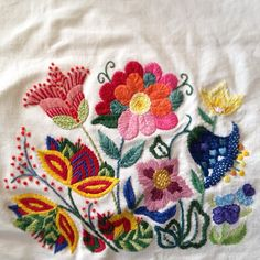 Tiny little embroidery in linen by Elna Carr.