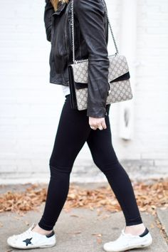 The perfect, casual chic + slightly edgy look for the weekend via For All Things Lovely | black leather All Saints jacket, Sincerely Jules graphic tee, Zella leggings, Gucci handbag, Goose sneakers, David Yurman bracelet stack and Celine sunnies are my go-to weekend staples