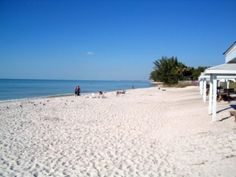Gasparilla Island FL Travel+Leisure 12/2012 Best Beach Towns.  West coast of FL.  No matter where you are in FL, you're never more than 60 miles from the ocean.  Park your bike on the one-lane road & search for lightning whelks at low tide, then head to 1890's lighthouse to look for roseate spoonbills.  Fish for tarpon then kick back on the porch of the Gasaparilla Inn & Club.  Hudson's is a popular small town feel lunch spot.  Go for an ice cream cone on main street.