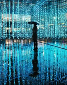 This beautiful light installation is called Aeolian Light and is made up of thousands of points of light floating and changing in color in response to both the wind and human movement. In Salford Quays, in Manchester, England.