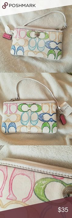 """NEW! Coach //Hampton Scribble Signature Wristlet **Authentic Coach ** Style: # F40422  Measurements:  approximately 8""""W x 4.5"""" H. It has white leather trim and silver tone hardware that has """"Coach"""" engraved (See Photo 4). It has an embossed pink leather hangtag and a top zip closure. It also has a slip pocket with khaki interior.   IMPORTANT: See Photo 3 - Slight color fading Coach Bags Clutches & Wristlets"""