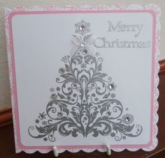 Indigo Blu stamp embossed with silver Wow powder and a few gems added