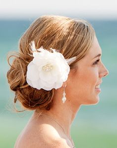 Low Updo Wedding Hairstyle with Flower Accessory