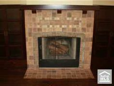 new fireplace in historic home with Batchelder style tiles