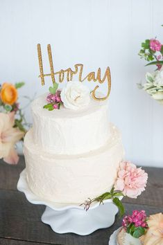 Gold Personalized Wedding Cake Topper. white simple wedding cake with one flower. Found on Etsy.