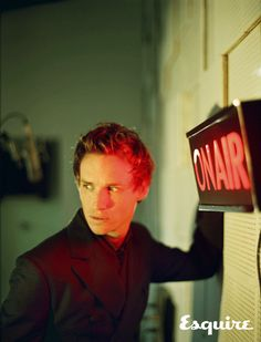 Red: the color of the sign. Black: the suit he wears so well.  Eddie Redmayne :)