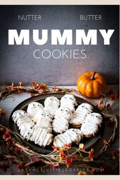 These are the most adorable fall cookies - nutter butter mummy cookies! An easy cookie that you can make with kids for a delicious treat! #fallcookies #mummycookies #halloweencookies