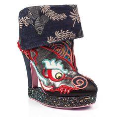 <p>Roar roar like a dungeon dragon, these fierce platform heeled boots are the ultimate in stand out irregularity. Featuring a metallic applique dragon upper with a patterned fold over detail, an iridescent heel all set upon a multi glitter continuous platform.</p> <ul> <li>High heeled plarform boots</li> <li>Embroidery</li> <li>Applique</li> <li>Chinese knot button detail</li> </ul>