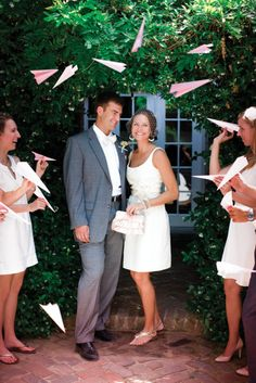 Have your guests throw pink paper planes instead of rice.