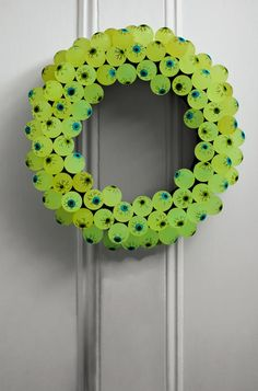 Creepy! This eerie DIY wreath is made from glow-in-the-dark rubber eyeballs.   #halloween #crafts