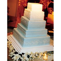 Pale Wedgewood blue ombre wedding cake designed after a Jasperware pattern.