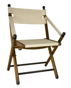 Campaign Nautical Folding Chair. Specific Type: British Military Campaign Style Officer's Chair  Material: Wood & Fabric  Finish: Hand Varnished     Style: British Colonial  Upholstery Fabric: Canvas    This is a classic recreation of an Campaign Chair. This style chair Originally was used on safari, or expeditions when space was limited to what you could carry on a horse or mule - also by the British Imperial Army as an officer's chair when in camp. This 19th C. replica campaign chair is…