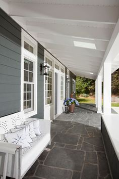 I want to have some sort of stone patio out back - change slider to French doors.