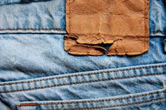 Blank Leather Jeans Label Sewed On A Blue Jeans. Stock Photo, Picture And Royalty Free Image. Image 11387786.