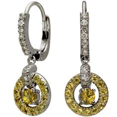 Classic Diamond Hoops With Hanging Sapphire Circles -  These earrings is adorned with a combined weight of 0.99ct of brilliant round diamonds and yellow sapphires.    Petite circular earrings with a French closure have both diamonds and yellow sapphires in 14K white gold. There is a rounded section with yellow sapphires surrounding a larger yellow sapphire in the center, and bright sparkling diamonds on the hinged section. Fun to wear and chic, these versatile earrings are reasonably…