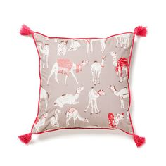 Inspired by the Pushkar Camel Fair the Different Different Camels Cushion showcases the pageantry of the fair, with visions of camels adorned with flowers, beads and appliquéd coats.