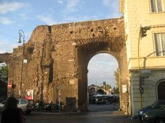 The entrance to the Porta Portese Market. The sign just to the left says Porta Portese. - Sunday 7AM-2PM