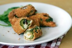 Dill Pickles stuffed with cheddar cheese and bacon, coated in panko bread crumbs and deep-fried.