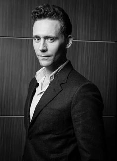 Tom Hiddleston wears his black suit and white shirt.