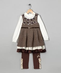 Sweet and sophisticated, this set features a dress with delicate flower appliques and sequins. A girly shirt with a neckline full of frills adds charm, while matching stretchy leggings boast ruffle details, cozy construction and an elastic waistband for all-day comfort. Includes dress, shirt and leggings100% polyesterMac...