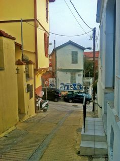 and the narrow streets that spawn from it, are home to some of the most beautiful buildings in all of Ano Poli. (Walking Thessaloniki / Route Ano Poli b) Thessaloniki, Spawn, Beautiful Buildings, Most Beautiful, Walking, Street, Woking, Walkway, Hiking