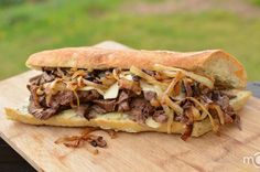 "This sandwich is the ""bomb""! My husband loves steak and I am too bored with a simple slice of meat. To mix things up a bit, I made this sandwich for dinner the other day and it turned out heavenly. Flavorful steak with sweetness from onions, some melted cheese and a kick of garlic, yumm! Tips listed in this recipe: An easy way to prepare a perfect steak that is moist and flavorful and you don't even need a grill. Preparing herb butter spread that you can use for garlic bread or with stake."