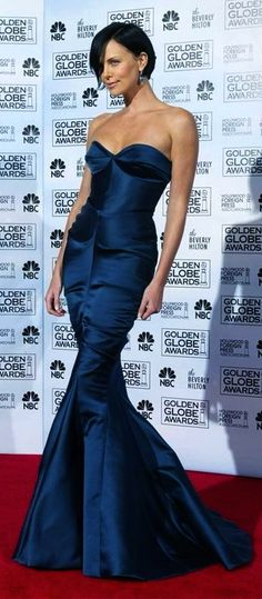 Charlize Theron -- www.whitesrose.etsy.com Go here for your Dream Wedding Dress & Fashion Gown!