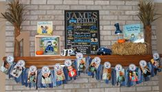 little blue truck birthday party decorations - little blue truck mantle with a little blue truck first birthday sign from etsy and little blue truck banner garland!