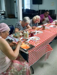 The class painting pumpkins for Halloween at the Wakulla Senior Center in Crawfordville, FL.