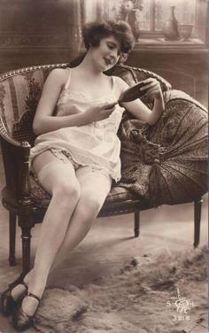 PHOTO  LIKELY FOR ARCADE CARD  WOMAN ON LOVESEAT IN SHORT SLIP AND SILK STOCKINGS LOOKING IN