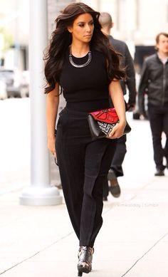Kim Kardashian- all black, statement necklace & right clutch.