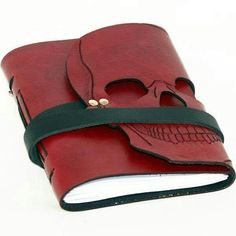 Get inspired with this pocket-sized, hand-carved skull book. The unique cut away silhouette design makes this journal more than just another skull in the crow… Skull Rock, Skull Art, Silhouette Design, Journal En Cuir, Mode Sombre, Gothic, Leather Bound Journal, Handmade Journals, Handmade Notebook