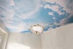 Sky ceilings We can do this look by digitally printing a photograph on your stretch ceiling before installing it. For more realism, use a translucent stretch membrane with LED lighting behind it. http://www.laqfoil.com/