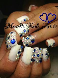 White and blue bling. Mariel's nails art via Facebook