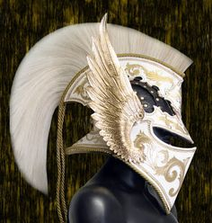 Archangel helmet by Samuel Lee of Prince Armory. The crest is made of horse hair, and the visor can be lifted or removed completely. And of course, it goes with the amazing archangel armor.  All leather.  Handmade.  http://www.princearmory.com/