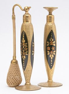 PYRAMID Perfume atomizer and bottle in enameled and gilded glass with gilded metal hardware, 1920s.