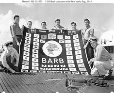 Members of USS Barb's demolition squad, Pearl Harbor, August 1945. These men went ashore at Karafuto, Japan, and planted an explosive charge that wrecked a train. This raid is represented by the train symbol in the middle bottom of the battle flag. (US Navy photo: NH 103570)