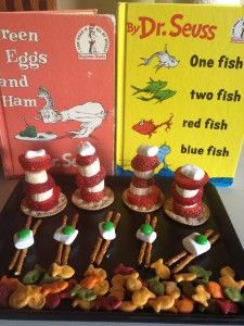 Dr. Seuss  snacks.  Cat in the hat - Starwberries and banana slices  Green eggs and ham - Pretzels white chocolate or marshmallow and green m  One Fish Two Fish - colored Goldfish crackers