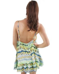 """Cool greens and blues pop against bright yellow and orange in this unique printed dress. Adjustable straps let you decide on the amount of skin you show. The flare style and raw bottom edge add a carefree vibe, great for festivals and beach vacations. Add leggings, booties and a leather jacket when fall and winter comes along, for a sweet yet edgy look!   By Cotton Candy  100% Polyester  Loose Fit  Raw Edge   Model Info: Height: 5'9"""" 