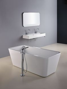 Vomano 120cm basin with two tapholes, Savutto freestanding bath, from Sottini. #bathroomdesign