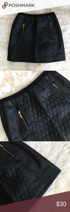 """Athena Marie Black Faux Leather Quilted Skirt New with tags, excellent condition. Material body is 100% polyurethane & black shell 100% polyester. All over black faux leather with a canvas-like feel elastic waistband. Front side pockets with gold exposed zippers. Back centered gold exposed zipper. Waist is 15"""", length is 19"""". ❌NO TRADES OR PAYPAL❌ Athena Marie Skirts Mini"""