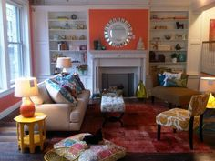 We love the pop of orange behind above the fireplace! It's definitely Boho-styled.   Find out what type of home decor personality you have by taking our Stylescope quiz. Click here!