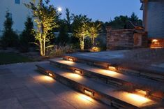 When designing your backyard, don't forget to carefully plan your lighting as well. Get great ideas for your backyard oasis here with our landscape lighting design ideas. Outdoor Stair Lighting, Backyard Lighting, Outdoor Light Fixtures, Led Fixtures, Outdoor Step Lights, Patio Steps, Outdoor Steps, Modern Landscaping, Outdoor Landscaping