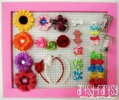 Hair Bow Holder - large painted picture frame without the glass, add thin wire so the clips can snap around it, and add canisters for the pony tail holders and ties for the headbands - I am totally making one of these IMMEDIATELY!